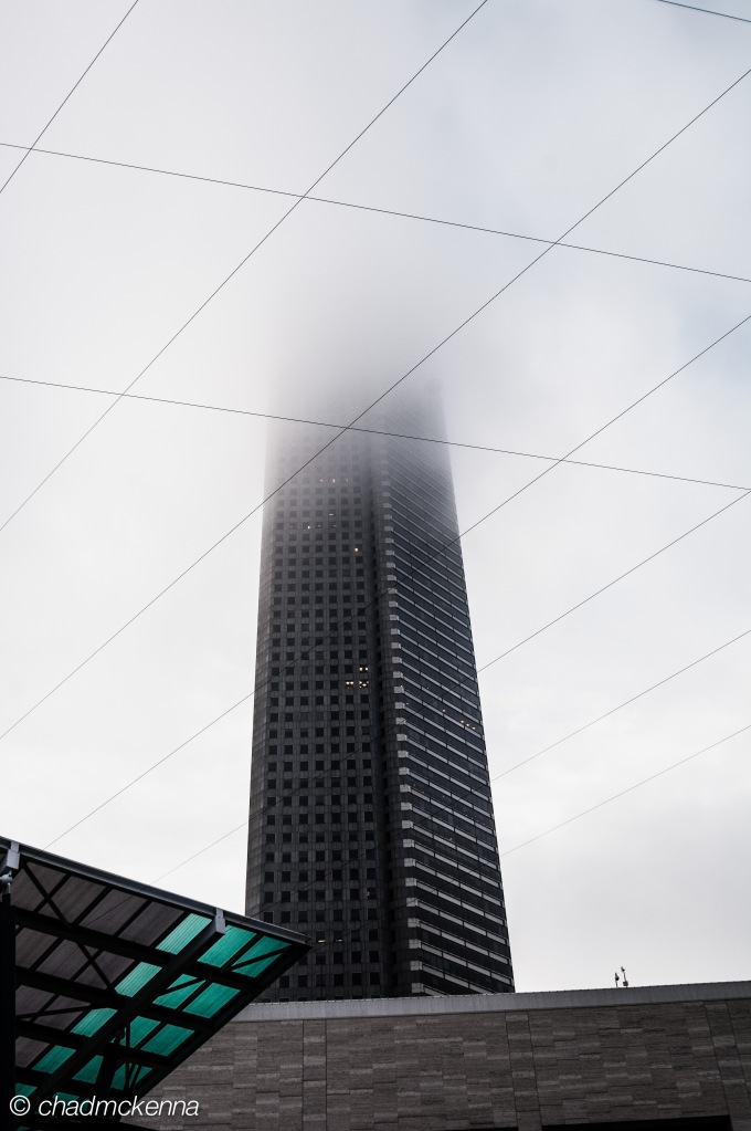 Building disappearing in the fog